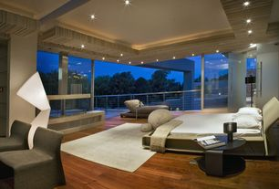 Contemporary Master Bedroom with Columns, Hardwood floors