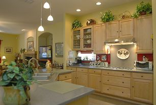 Country Kitchen with KraftMaid Cabinetry Maple Square Raised Panel In Parchment, Limestone, Inset cabinets, Glass panel