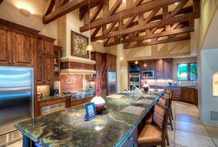 Contemporary Kitchen with Raised panel, full backsplash, European Cabinets, Flush, flush light, Limestone Tile, warming oven