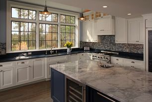 Traditional Kitchen with Instant hot water dispenser, single handle, Kitchen island, Raised ceiling, Hardwood floors