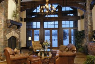 Rustic Living Room with stone fireplace, Chandelier, MS International Golden White Quartzite Tile, Hardwood floors