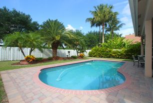 Tropical Swimming Pool with Raised beds, exterior stone floors, Fence