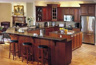 Craftsman Kitchen with Stone Tile, Breakfast bar, Limestone Tile, Nova Brown, Granite by Arizona Tile, Crown molding