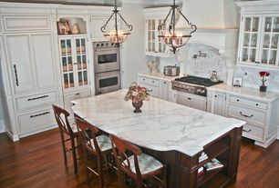 Traditional Kitchen with Kitchen island, Napoleon rush seat barstool, counter height, Breakfast bar, Complex Marble, L-shaped