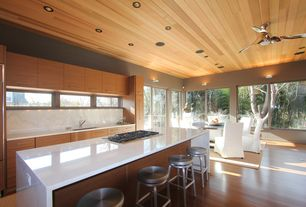 Contemporary Kitchen with Wall sconce, Crate & Barrel Spin Bar Stools, Kitchen island, Breakfast bar, Wood panel ceiling