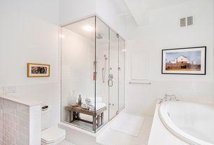 Contemporary Master Bathroom with Handheld showerhead, Master bathroom, frameless showerdoor, limestone tile floors