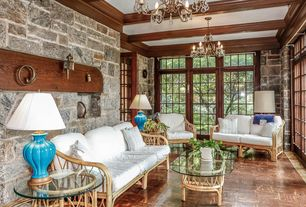 Traditional Living Room with Chandelier, Interior stone wall, French doors, Bamboo furniture, Parquet hardwood floor