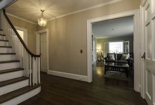 room with French doors, Pendant light, Crown molding, Hardwood floors