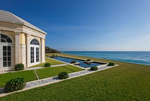 Contemporary Swimming Pool with Pathway, Transom window, Lap pool, Arched window, French doors, exterior stone floors