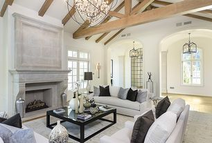 Eclectic Living Room with Espresso suede accent pillow, Herringbone tile pattern, Hardwood floors, High ceiling, Chandelier