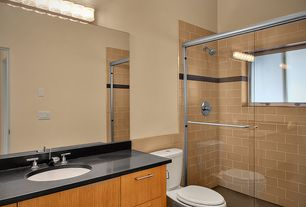 Contemporary Full Bathroom with Soapstone, European Cabinets, Flush, Undermount sink, Soapstone counters