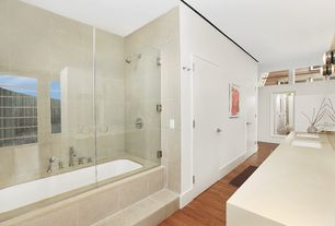 Contemporary Master Bathroom with frameless showerdoor, Undermount sink, Double sink, Limestone counters, Hardwood floors