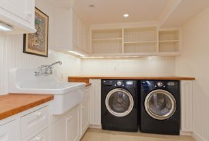 Cottage Laundry Room with limestone tile floors, Beadboard, Hanging Bar, Butcher block counter, Wainscotting, Paint