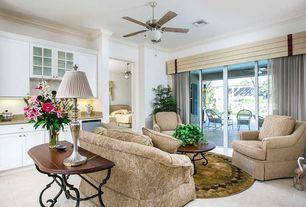 Traditional Living Room with Ceiling fan, Crown molding, slate tile floors, Built-in bookshelf
