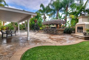 Tropical Patio with exterior stone floors, outdoor pizza oven, Raised beds, Outdoor kitchen, Gazebo, Fence