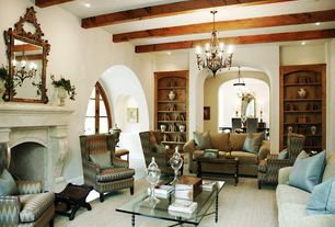 Traditional Living Room with French doors, Carpet, Built-in bookshelf, metal fireplace, Exposed beam, Chandelier