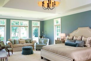 Traditional Master Bedroom with Upton home 'corey' turquoise upholstered arm chair, Crown molding, Tufted ottoman, Chandelier