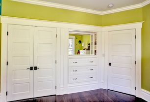 Cottage Kids Bedroom with French doors, Hardwood floors, Crown molding, Built-in bookshelf