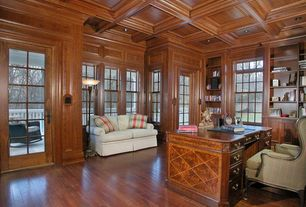 Traditional Home Office with picture window, Built-in bookshelf, Casement, Hardwood floors, French doors, can lights