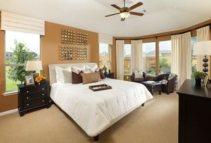 Eclectic Master Bedroom with Crate and barrel streeter leather swivel chair, Standard height, can lights, double-hung window
