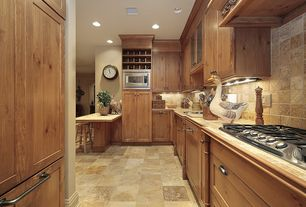 Country Kitchen with electric cooktop, Flush, built-in microwave, Limestone Tile, European Cabinets, stone tile counters