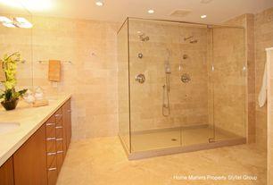 Contemporary Master Bathroom with MS International Pyramid Gold Limestone, Flush, Undermount sink, Rain shower, Limestone