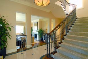 Traditional Staircase with specialty window, Hardwood floors, flush light, Spiral staircase, High ceiling