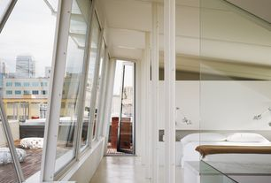 Contemporary Master Bedroom with French doors, Concrete floors, High ceiling
