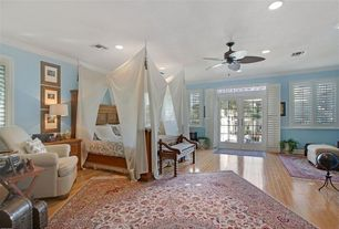Traditional Master Bedroom with Hardwood floors, Casement, Transom window, Standard height, French doors, Crown molding