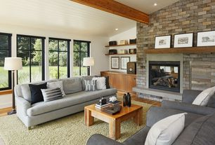 Contemporary Living Room with Built-in bookshelf, French doors, Hardwood floors, Exposed beam