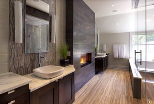 Contemporary Master Bathroom with Complex marble counters, Flush, European Cabinets, Handheld showerhead, Wall sconce