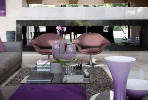 Contemporary Living Room with sandstone floors, Artifort little tulip armchair, Pendant light, High ceiling