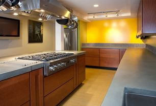 Contemporary Kitchen with L-shaped, Soapstone counters, Island Hood, Flush, Simple Granite, can lights, flush light