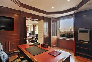 Traditional Home Office with Built-in bookshelf, Standard height, Hardwood floors, can lights, specialty door, Wainscotting