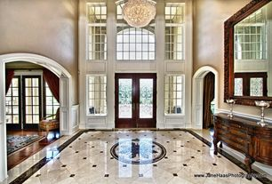 Traditional Entryway with Wainscotting, French doors, complex marble floors, Chair rail, Cathedral ceiling, Chandelier