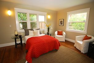 Traditional Guest Bedroom with Lofty Quilted Coverlet, EKTORP TULLSTA Chair, Wall sconce, Hardwood floors