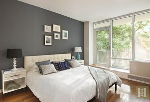 Contemporary Master Bedroom with French doors, Hardwood floors, Transom window