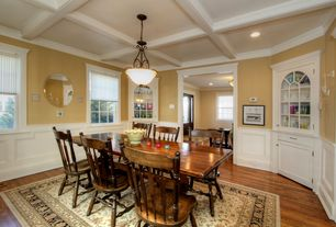 Traditional Dining Room with Built-in bookshelf, Crown molding, Pendant light, Box ceiling, Hardwood floors, Wainscotting