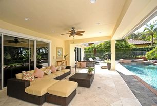 Tropical Porch with exterior stone floors, Paint 2, sliding glass door, Fence, Paint