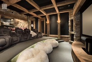 Rustic Home Theater with specialty door, Stacked stone wall, Wainscotting, Carpet, Custom Wood Stage, Exposed beam