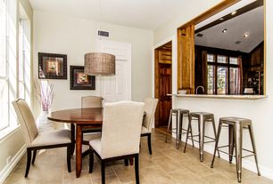 Contemporary Dining Room with Pendant light, limestone tile floors