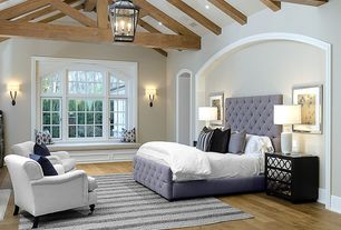 Eclectic Master Bedroom with Lantern chandelier, Phoebe Tufted Queen Bed, Mirrored furniture, flush light, Hardwood floors