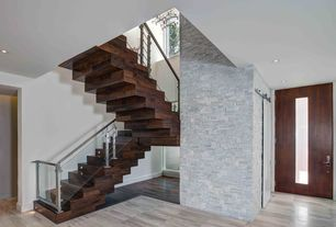 Modern Staircase with Hardwood floors, Chandelier, High ceiling