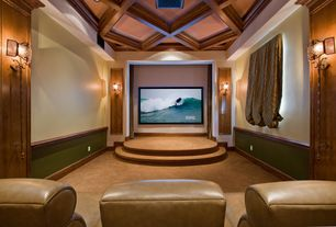 Traditional Home Theater with Home theater seating, Chair rail, Exposed beam, Wall mounted light, Light blocking drapery
