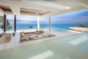 Tropical Patio with Trellis, Pathway, exterior tile floors, Skylight, Infinity pool