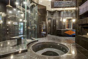 Modern Master Bathroom with Slate counters, frameless showerdoor, Rain shower, simple granite tile floors, Flush, Wall sconce
