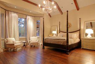 Traditional Master Bedroom with Exposed beam, Casement, can lights, Hardwood floors, Chandelier, Standard height