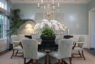 Traditional Dining Room with Crown molding, Hardwood floors, Box ceiling, Chandelier, specialty door, Wainscotting