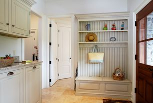 Country Mud Room with specialty door, High ceiling, Built-in bookshelf, Pental quarts in pearl white, Glass panel door