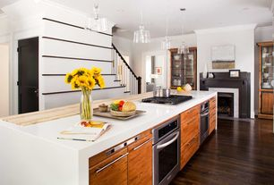 Contemporary Kitchen with Simple marble counters, L-shaped, European Cabinets, specialty door, Pendant light, Crown molding